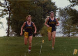 Theresa (Bender) Pape and Tracey (Skorseth) Kujawa running cross-country meet, 1979-1981