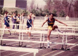 Hurdler Angela Williams leading a race, 1980