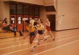 Women's relay team passing the baton, 1979