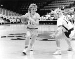 Joan (Pitrof) Flayter drives basketball down court, 1986 - 1987
