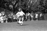 Kim Ratliff kicks soccer ball, 1993