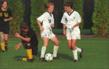 Mary Revnew and Angie Fluckiger defend the soccer ball, 1994