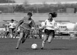 Kelly Franklin defends soccer ball, 1993