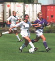 Danielle (Henion) Murphy dribbles soccer ball down field, 1994