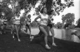 Marquette women compete in cross-country race against University of Wisconsin--Milwaukee, 1990