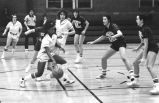Deborah Stampley-Jones dribbles ball around opponent, 1982