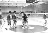 Women's volleyball team shakes hands with opponents, 1977