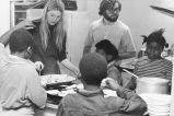 Marquette students serve food to children, 1970