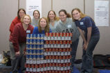Marquette students stand behind an American flag constructed of donated food items, 2004