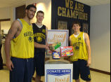 Marquette men's basketball players make a donation to Hunger Task Force, 2003