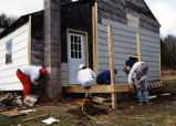 Marquette students work on a home exterior, 1995
