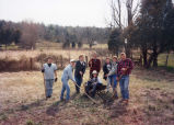 Marquette students take a break from clearing the work site, 1991