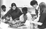 Marquette students help children prepare food, 1969-1970