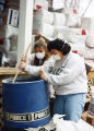 Marquette students prepare insulation at a Habitat for Humanity site, 1995