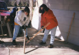 Marquette students sand boards for a house, 1997