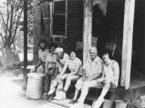Marquette students take a break on the porch with community residents, undated