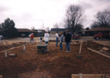 Marquette students prepare a housing site, 1996