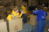 Marquette students help sort canned items as a part of Mission Week, 2003