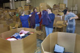 Marquette students sort clothing as a part of Mission Week, 2003