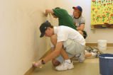 Marquette students clean walls as part of an orientation week service project, 2003