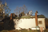 Marquette students work on a roof at a Marquette Action Program site, 1997