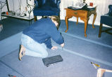 A Marquette student puts together shelves at a L'Arche site, 1997