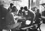 Marquette University Community Action Program volunteers assist youngsters wtih art projects, 1969