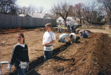 Marquette students prepare the area for a foundation, 1997