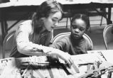 A Marquette student tutors a child, 1972