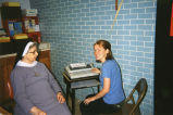 Bridget Watts assists Sr. Lenore with records in the Resurrection Catholic School office, 2000