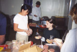 Marquette Action Program volunteers prepare sandwiches assembly-line style, 2000