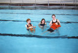 Bridget Watts, Rebecca (Becky) Polakowski, and Sarah Carpenter swim with children in a therapeutic...
