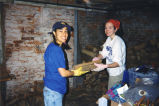 Marquette students work to fix up a L'Arche family home as part of a Marquette Action Program...