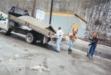 Marquette volunteers unload stone from a truck, 2001