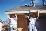 Marquette Action Program Volunteers work on a house in Enid, Oklahoma, 2000