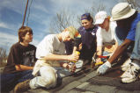 Volunteers work on the roof as part of a Marquette Action Program service trip, 2000