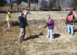 Christopher McBride and Jill Geisler rake pasture, 1999