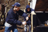 Marquette students Matt Murphy and John LaDisa build a trash receptacle, 1999