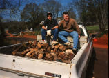Marquette students take a break from hauling firewood