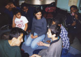 Marquette student Nayna Purohit talks with students from PS 142, 1999