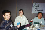 Marquette students show their tickets to the high-income table at a hunger banquet