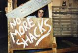 A Marquette student occupies a shack built as a part of National Hunger and Holmelessness...