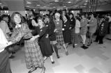 Marquette students dance with senior citizens at the Senior Prom, 1991