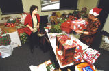 Marquette staff members prepare gifts for the Holiday Giving Tree, 1998