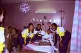 Members of the Marquette women's basktball team visit with a patient at Children's Hospital, 1998