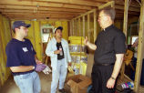 Marquette University President Robert A. Wild, S.J. visits with Habitat for Humanity volunteers,...