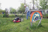 A Marquette student mows a lawn during Senior Week, 2006