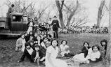 Rev. Stephen McNamara, S.J. and children at picnic, 1932