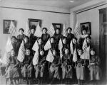 Girl students with American flags, 1910? - 1920?
