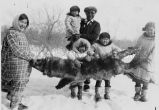 Hunter and children in snow with wolf fur, 1938?